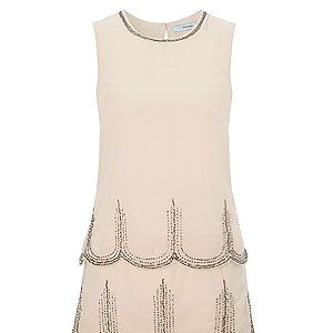 <p>This Flapper-style dress is spot on and an absolute style steal! We like the modern take on a classic style, without looking overly fancy dress - and a sexy way of doing Twenties 'tennis whites', no?</p>