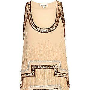 <p>You'll be a deco dream in this little number! With a stepped hem, hanging beads and heavy embellishment, this decadent tank top is the modern way to inject some flapper fun into your going out look.</p>