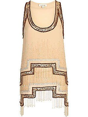 "<p>You'll be a deco dream in this little number! With a stepped hem, hanging beads and heavy embellishment, this decadent tank top is the modern way to inject some flapper fun into your going out look.</p> <p>Stepped hem embellished tank top, £50, <a title=""River Island"" href=""http://www.riverisland.com/women/tops/going-out-tops/Bronze-stepped-hem-embellished-tank-top-632542"" target=""_blank"">River Island</a></p>"