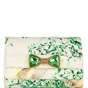 """<p>This Ted Baker bag, complete with floral print and emerald crystal bow, is almost too pretty for words.</p><p>Clutch, £79, <a href=""""http://www.tedbaker.com/women%27s/women%27s_accessories/bags/list.aspx#page=2&styCode=105519&colRef=39-LIGHT%20GREEN&path=/women's/women's%20accessories/bags/"""" target=""""_blank"""">Ted Baker</a></p>"""