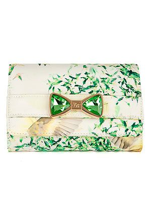 <p>This Ted Baker bag, complete with floral print and emerald crystal bow, is almost too pretty for words.</p>