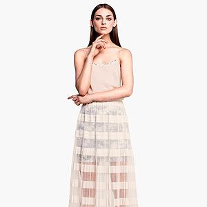 """<p>Go nude this summer and flash a bit of leg with H&M's calf-length pleated sheer skirt. Just the right side of sexy.</p><p>Skirt, £29.99, <a href=""""http://www.hm.com/gb/product/13503?article=13503-B"""" target=""""_blank"""">H&M</a></p>"""