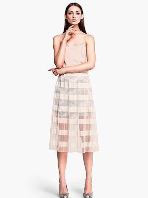 <p>Go nude this summer and flash a bit of leg with H&M's calf-length pleated sheer skirt. Just the right side of sexy.</p>