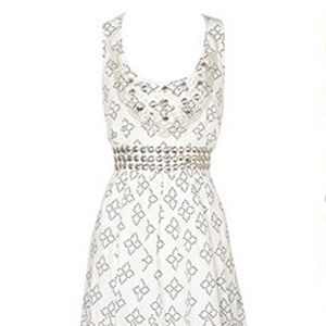 """Great for day and even better for night dressed up with heels or gorgeous gladiators, it's a summer essential.<br /><br />£55, <a target=""""_blank"""" href=""""http://www.oasis-stores.com/fcp/product/Oasis//Studded-dress/3770009102?colour=white"""">www.oasis-stores.com</a><br />"""