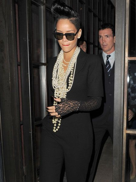 Rihanna showed off her towering quiff which seems to get taller and taller each time we see her. The singer left Shoreditch House in London in the early hours following the after-party for film 'Inglorious Basterds' dressed in black and dripping in pearls...  <br />