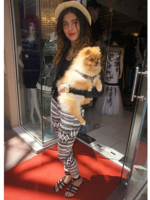 <p>We can't take our eyes away from Romeo, the cute Pomeranian dog - the pup has style! And so does his owner, Marshal Aattai. The chic French girl looked gorgeous in her Topshop printed trousers and hat combo.</p>