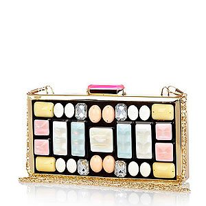 <p>This cute clutch is a gem of a find and a proper piece of decadent arm candy! The stuck-on stones have a DIY feel - if anyone asks, we made it ourselves, 'kay?</p>