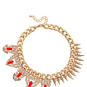 """<p>Can't decide between punky spikes or baroque diamante? No need to with this mixed up necklace. One half diamante and gold studs, one half red faceted jewels and diamante, it's genius in jewellery. Clever Asos.</p><p>Necklace, £40, <a href=""""http://www.asos.com/ASOS/ASOS-Mix-It-Necklace/Prod/pgeproduct.aspx?iid=2972690&cid=4175&sh=0&pge=0&pgesize=204&sort=-1&clr=Orange"""" target=""""_blank"""">Asos</a></p>"""