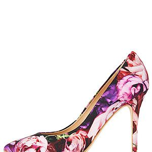 """<p>These floral beauties are bound to put a spring in your step and make your summer wardrobe bloom.</p><p>Courts, £58, <a href=""""http://www.topshop.com/webapp/wcs/stores/servlet/ProductDisplay?beginIndex=1&viewAllFlag=&catalogId=33057&storeId=12556&productId=10888490&langId=-1&sort_field=Relevance&categoryId=277012&parent_categoryId=208491&pageSize=200"""" target=""""_blank"""">Topshop</a></p>"""