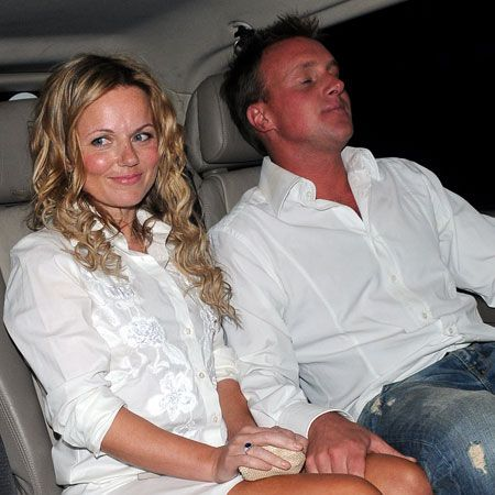 """<a target=""""_blank"""" href=""""tags/geri-halliwell"""">Geri Halliwell</a> is still looking loved-up with her posh totty, Henry Beckwith cousin of socialite Tamara Beckwith, at Walliam's west London bash. We think she may have borrowed  her boyfriend's shirt (that look is so in now) but obviously forgot to put any trousers on... Oh and Happy Birthday David!"""