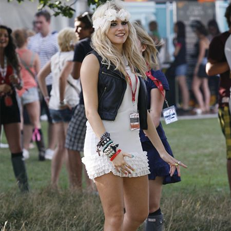 Festival fashionista Pixie wore a cute flowered head band with a cool zippered waistcoat and biker boots. She later performed a set in The Arena<br />