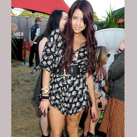 A purple-haired Peaches partied in a printed playsuit and lace-up boots<br />