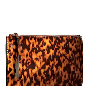 """<p>Whether on sunglasses or clutches, there's nothing chicer than tortoiseshell print. Team this clutch with a black jumpsuit a la Victoria Beckham. </p><p>Clutch, £14.99, <a href=""""http://www.hm.com/gb/product/14699?article=14699-A"""" target=""""_blank"""">H&M</a></p>"""