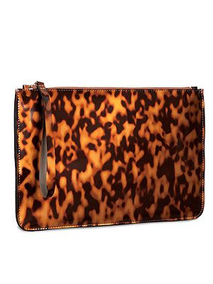 "<p>Whether on sunglasses or clutches, there's nothing chicer than tortoiseshell print. Team this clutch with a black jumpsuit a la Victoria Beckham. </p> <p>Clutch, £14.99, <a href=""http://www.hm.com/gb/product/14699?article=14699-A"" target=""_blank"">H&M</a></p>"