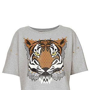 """<p>Surf onto Kenzo's tiger top trend with this embellished crop top from Topshop. Wear with a high-waisted tulle skirt to add a girly touch.</p><p>Top, £24, <a href=""""http://www.topshop.com/webapp/wcs/stores/servlet/ProductDisplay?beginIndex=1&viewAllFlag=&catalogId=33057&storeId=12556&productId=11108375&langId=-1&sort_field=Relevance&categoryId=277012&parent_categoryId=208491&pageSize=2000"""" target=""""_blank"""">Topshop</a></p>"""