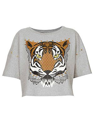 "<p>Surf onto Kenzo's tiger top trend with this embellished crop top from Topshop. Wear with a high-waisted tulle skirt to add a girly touch.</p> <p>Top, £24, <a href=""http://www.topshop.com/webapp/wcs/stores/servlet/ProductDisplay?beginIndex=1&viewAllFlag=&catalogId=33057&storeId=12556&productId=11108375&langId=-1&sort_field=Relevance&categoryId=277012&parent_categoryId=208491&pageSize=2000"" target=""_blank"">Topshop</a></p>"