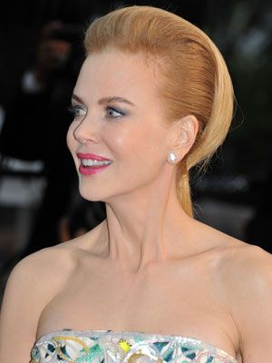 <p>This style looks stunning and is actually a really sophisticated style that would work for a wedding or on the red carpet. Nicole Kidman worked this look well even though she has naturally curly hair. It's a great look to wear if you are wearing a patterned outfit, you know the rules wear a statement outfit and keep your hair and makeup minimal.</p>