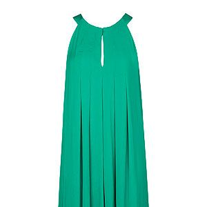 """<p>Forget any preconceptions that jumpsuits are frumpy trend better left in the 90s. This season they get a chic makeover with flared shapes, silky fabrics, and eye-popping brights. Paired with a statement necklace, futuristic heel or courts they make for the perfect cocktail ensemble.</p><p>Jumpsuit, £40.49, <a href=""""http://shop.mango.com/GB1/p0/mango/clothing/jumpsuits/halter-neck-flared-jumpsuit/?id=11080054_24&n=1&s=prendas.monos&ie=0&m=&ts=1372947298241"""" target=""""_blank"""">Mango</a></p>"""
