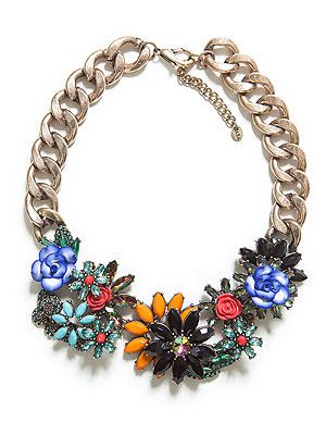 """<p>Crystal flowers in bright hues, multi-coloured diamantes and chunky gold chain… our simple white tees are crying out for Zara's statement necklace.</p> <p>Necklace, £29.99, <a href=""""http://www.zara.com/uk/en/new-collection/woman/accessories/jewelled-flowers-necklace-c269207p1296032.html"""" target=""""_blank"""">Zara</a></p>"""