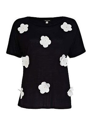 """<p>SO of-the-moment, with a girly twist, this 3D flower t-shirt channels spring's monochrome trend. And guess what? It's only £15! (No, we can't believe it either..)</p> <p>3D flower t-shirt, £15, <a title=""""River Island"""" href=""""http://www.riverisland.com/women/t-shirts--vests--sweats/plain-t-shirts--vests/Black-and-white-3D-flower-t-shirt-641271"""" target=""""_blank"""">River Island </a></p>"""