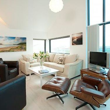 """<p>When someone says penthouse, I think of glass, steel and a city skyline, not the wild Cornish coast. But it's this contrast that makes Tregales so spectacular&#x3B; a contemporary interior (Charles Eames leather chair, anyone?) juxtaposed with the rugged landscape of Polzeath. The open-plan lounge and kitchen is a well-designed space for sitting around chatting while (someone else, hopefully) prepares the food which you can eat at the six-seater table or al fresco on the enormous terrace spanning the length of the penthouse. The three bedrooms (two en suite) are modern and immaculate and two have balcony access.</p><p>I adore properties that are full of character, so wasn't sure how I'd feel about an ultra modern apartment, but the reality is I ended up wanting to live there. From the massive fridge with icemaker to the cream L-shaped sofa, it was all so cool – like if MTV made an episode of (Cornish) Cribs or where a Cornish rock star might hang out. And if there are more than six in your gang, there's an option to book neighbouring penthouse Darwin, which holds another ten people. The apartment's location also makes it a must-visit&#x3B; a ten-minute walk (you can pick wild samphire for your picnic on the way) down to Polzeath Beach, which is dotted with rock pools, a cave and is one of the best places to learn to surf on the west coast. I booked a two-hour lesson with <a title=""""http://www.wavehunters.co.uk/"""" href=""""http://www.wavehunters.co.uk/"""" target=""""_blank"""">wavehunters</a> which cost £28 including board and wetsuit hire. Visit <a title=""""http://www.latitude50.co.uk/our-cottages/polzeath-holiday-cottages/the-penthouse-at-tregales"""" href=""""http://www.latitude50.co.uk/our-cottages/polzeath-holiday-cottages/the-penthouse-at-tregales"""" target=""""_blank"""">latitude50.co.uk</a>, prices from £650 per week (£108pp based on six people sharing).</p><p> </p>"""