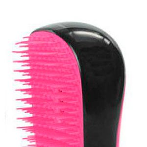 "<p>This is the only way to tackle washed-up locks that resemble seaweed. With unique convex teeth, the Tangle Teezer makes detangling pain-free and prevents damage. This mini version will fit in your beach bag no problem.<br />Compact Tangle Teezer, £11.99, <a title=""http://www.theukedit.com/tangle-teezer-compact-styler-black/pink/10304139.html"" href=""http://www.theukedit.com/tangle-teezer-compact-styler-black/pink/10304139.html"" target=""_self"">Cosmo Boutique</a></p>"