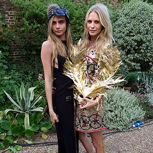 <p>In a double fashion whammy, the Delevingne sisters wowed in fancy dress at The Elephant Family presents 'The Animal Ball' party in London on Tuesday. Cara Delevingne opted for a black maxi that accentuated her long limbs, and accessorised with a black YSL shoulder bag and beaded headband. Meanwhile, sister Poppy went for gold in an embellished dress, heels and dramatic mask. </p>