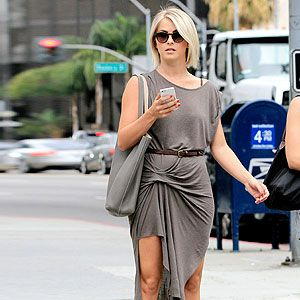 <p>Julianne Hough showed off her pins in an All Saints dress with thigh high split in LA on Wednesday. The taupe jersey dress was fitted in all the right places and a thin belt accentuated her waist. The actress teamed the clingy number with ankle cowboy boots and large tote.</p>