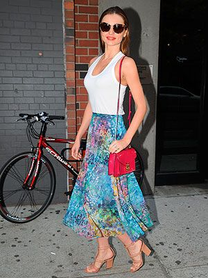 <p>It's safe to say Miranda Kerr's a regular on our best dressed list, and she didn't disappoint in her 70s inspired outfit while out and about in New York on Monday. The supermodel teamed a colourful print midi Isabel Marant skirt with tan block heels and a raspberry patent Louis Vuitton bag. Slicked back hair, red lippie and oversized shades added the finishing touches to the simple outfit. We love. </p>