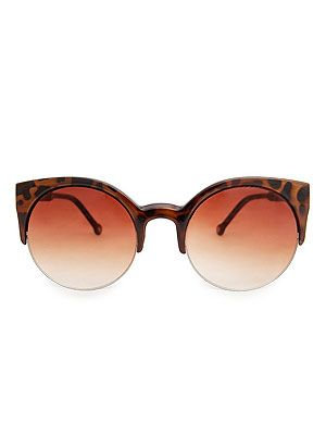 "<p>Mix futuristic and retro with a pair of clean round sunglasses with half cat eye tortoiseshell frames.</p> <p>Sunglasses, £17.99, <a href=""http://shop.mango.com/GB1/p0/mango/accessories/sunglasses/touch---half-frame-kitten-sunglasses/?id=16020047_06&n=1&s=accesorios.gafas&ie=0&m=&ts=1373883240771"" target=""_blank"">MANGO</a></p>"