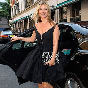 <p>Kate Moss was only meeting friends for lunch yesterday, but she certainly dressed up for the occasion. She arrived at The Ivy in a black Prada prom dress with sexy zip detail on the bodice, and jazzed it up with neon sandals and a zebra print clutch. Trust Kate to make a prom dress look sexy.</p>