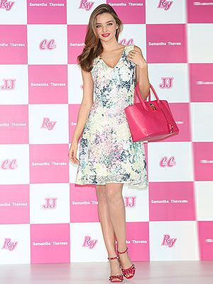 <p>Isn't Miranda Kerr just the poster girl for summer in this cute get-up? The model attended the Samantha Thavasa Ladies Tournament in Japan today in a cute floral print dress, but what really caught our eye was the attention to detail. Hot pink lips, matching bags and heels, it doesn't get more polished than that.</p>
