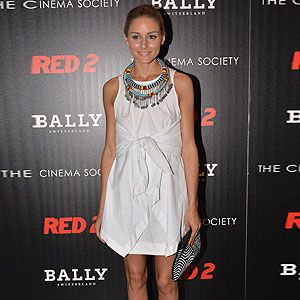 <p>Rarely a week goes by when Olivia Palermo doesn't top our best dressed list, and here she is again, wowing us with her simple yet elegant outfit. The model attended the Red 2 screening in New York on a Tuesday in a little white dress with bow front. Olivia teamed it with sexy white, blue, red and yellow Christian Louboutin sandals and a statement necklace in matching shades. Another winning look.</p>