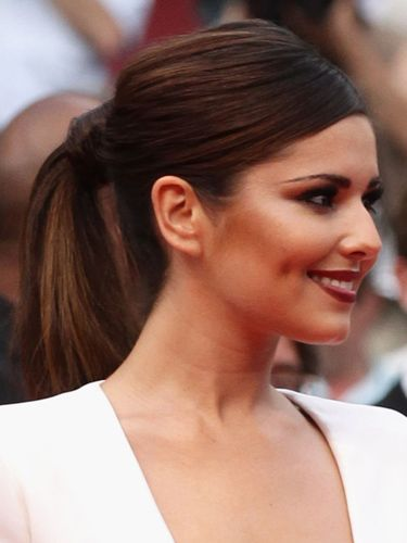 Cheryl looked super-sexy at the Cannes Film Festival with her dramatic makeup and gorgeous sleek ponytail.