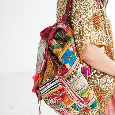 """<p>A riot of colour and texture combine in a heady mix of sequins and bold primary hues. Inspired by Indian markets and exotic embellishment this rucksack is a true feast for the senses.</p><p><a href=""""http://www.missselfridge.com/en/msuk/product/clothing-299047/inspired-by-2054440/inspired-byrucksack-2145357?bi=1&ps=40"""" target=""""_blank"""">INSPIRED BY RUCKSACK</a>, £100 Miss Selfridge http://www.missselfridge.com/en/msuk/product/clothing-299047/inspired-by-2054440/inspired-byrucksack-2145357?bi=1&ps=40</p>"""