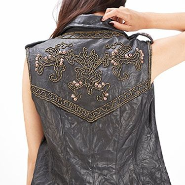 """<p>A gorgeous leather jacket cut without arms for en edgy finish that offsets flippy summer dresses brilliantly.</p><p><a href=""""http://www.missselfridge.com/en/msuk/product/clothing-299047/inspired-by-2054440/inspired-by-leather-gilet-2128715?bi=1&ps=40"""" target=""""_blank"""">INSPIRED BY LEATHER GILET</a>, £150 Miss Selfridge </p>"""