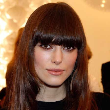 """""""Keira changes her hair regularly, but this style is one of my favourites,"""" says L'Oreal stylist Alain Pichon. """"I love the heavy, blunt fringe paired with long, glossy layers to show off her sexy eyes.""""  <br />"""