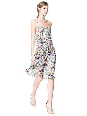 """<p>Get set for camisole dresses this AW13 - they're gonna be HUGE. Slip into a slip dress early and get ahead of next season with this pretty slinky number. We love.</p> <p>Strappy floral dress, £39.99, <a href=""""http://www.zara.com/uk/en/new-collection/woman/dresses/sarong-dress-with-straps-c269185p1296552.html"""" target=""""_blank"""">Zara</a></p>"""