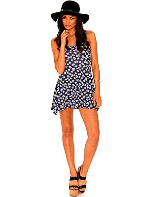 """<p>Channel some teen spirit in a glam grunge way with this ditsy daisy print slip dress from Missguided. Wear with stompy boots and ankle socks for an uthentic look, or team with tan sandals and oversized shades if you're holidaying in the sun.</p> <p>Marcy strappy daisy print dress, £14.99, <a href=""""http://www.missguided.co.uk/catalog/product/view/id/77448/s/marcy-strappy-daisy-print-swing-dress/category/477/"""" target=""""_blank"""">Missguided</a></p>"""