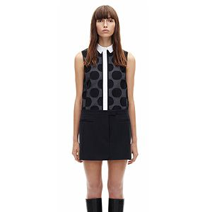 "<p>A sleeveless mini dress with black polka dots.</p><p>Sleeveless fils coupe dress, £640, <a title=""Victoria, Victoria Beckham"" href=""http://www.victoriabeckham.com/shop/category/victoria-victoria-beckham/sleeveless-fils-coupe-black"" target=""_blank"">Victoria, Victoria Beckham</a></p>"