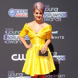 <p>You've got to love Kelly O, there's no other to make bold fashion choices. She went where no one's ventured before by teaming her gorgeous lilac beehive with a vibrant 50s-inspired yellow prom dress. Kelly brought the look up to date with a perspex clutch, gold heels and futuristic triangle drop earrings. Bold.</p>