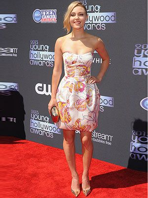 <p>AnnaSophia Robb proved just why she was the right person to fill Carrie Bradshaw's shoes in The Carrie Diaries when she walked the red carpet at the Young Hollywood Awards in Santa Monica. The TV star looked girly in a floral Pucci bustier dress, paired with metallic Stuart Weitzman shoes and matching Jimmy Choo clutch. A side fringe and coral makeup finished off the fun look. We heart.</p>