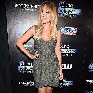 <p>Lauren Conrad kept things chic at the Young Hollywood Awards yesterday in a grey dress with bustier and tulip skirt. She wisely opted for minimalist metallic heeled sandals, hardly any jewellery and nude makeup. She did however add a pop of colour with her red nails. Simple yet effective.</p>