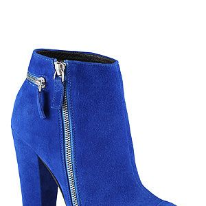 """<p>Colour-block all the way to winter with a pair of suede ankle boots with block heel. Perfect for accessorizing an eye-popping 90s slip dress or leather look trousers and embellished jumper.</p><p>Blue boots, £90, <a href=""""http://www.aldoshoes.com/uk"""" target=""""_blank"""">Aldo</a> (mid-July)</p>"""
