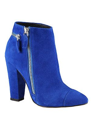 "<p>Colour-block all the way to winter with a pair of suede ankle boots with block heel. Perfect for accessorizing an eye-popping 90s slip dress or leather look trousers and embellished jumper.</p> <p>Blue boots, £90, <a href=""http://www.aldoshoes.com/uk"" target=""_blank"">Aldo</a> (mid-July)</p>"