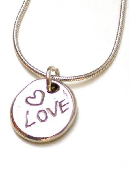 "These make a great gift but they're so sweet you'll probably just want to keep it yourself, I know I would!<br /><br />£32, <a target=""_blank"" href=""http://www.argentlondon.com/products/charms/silver-love-charm-pendant-token/"">www.argentlondon.com</a><br />"
