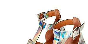 """<p>Add a spring to your step and a futuristic touch to your outfit with these iridescent multi-strap beauties from Topshop. Team with a little white dress for a minimalist look.</p> <p>Multi-strap sandals, £65, <a href=""""http://www.topshop.com/en/tsuk/product/new-in-this-week-2169932/new-in-this-week-493/jamboree-multi-strap-sandals-2166804?bi=1&ps=20"""" target=""""_blank"""">Topshop</a></p>"""