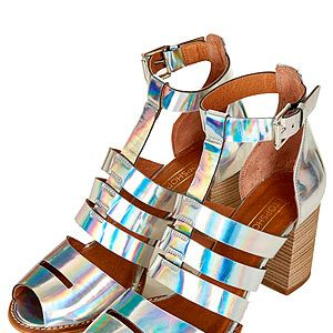 """<p>Add a spring to your step and a futuristic touch to your outfit with these iridescent multi-strap beauties from Topshop. Team with a little white dress for a minimalist look.</p><p>Multi-strap sandals, £65, <a href=""""http://www.topshop.com/en/tsuk/product/new-in-this-week-2169932/new-in-this-week-493/jamboree-multi-strap-sandals-2166804?bi=1&ps=20"""" target=""""_blank"""">Topshop</a></p>"""