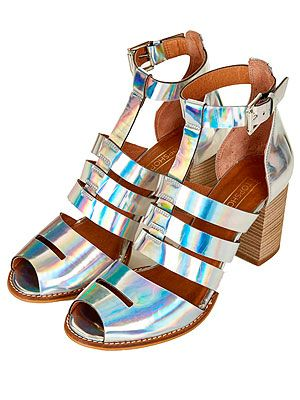"<p>Add a spring to your step and a futuristic touch to your outfit with these iridescent multi-strap beauties from Topshop. Team with a little white dress for a minimalist look.</p> <p>Multi-strap sandals, £65, <a href=""http://www.topshop.com/en/tsuk/product/new-in-this-week-2169932/new-in-this-week-493/jamboree-multi-strap-sandals-2166804?bi=1&ps=20"" target=""_blank"">Topshop</a></p>"