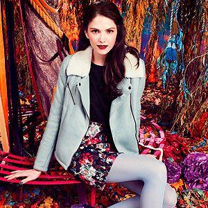 <p>Light blue leather shearling jacket £350<br />Floral skirt £40<br />Ankle boots £68<br />Black curve neck tee £18</p>